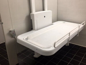 Hi lo changing table mounted on restroom partition